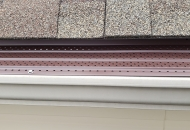 Gutter guards in several colors installed