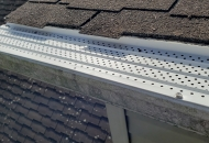 White leaf guards installed on gutters