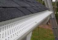 White gutter protection installed