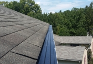Gutter guards on a high roof