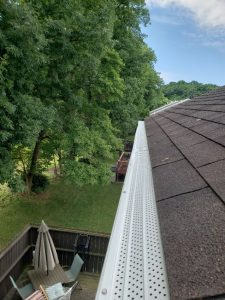 Gutter protection installed on high roof